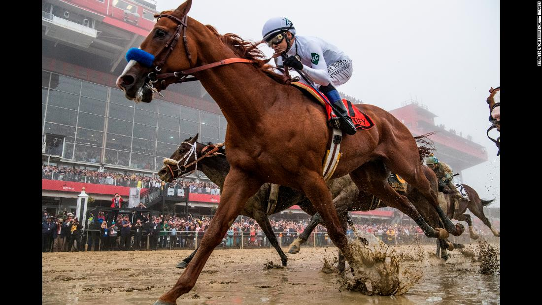 Justify, ridden by jockey Mike Smith, wins the Preakness Stakes at Pimlico Race Course on May 19, 2018, in Baltimore.