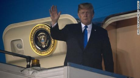 "US President Donald Trump waves after Air Force One arrived at Paya Lebar Air Base in Singapore on June 10, 2018, ahead of his planned meeting with North Korea's leader. - Kim Jong Un and Donald Trump will meet on June 12 for an unprecedented summit in an attempt to address the last festering legacy of the Cold War, with the US president calling it a ""one time shot"" at peace. (Photo by SAUL LOEB / AFP)        (Photo credit should read SAUL LOEB/AFP/Getty Images)"