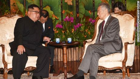 North Korea's leader Kim Jong Un  talks with Singapore's Prime Minister Lee Hsien Loong during his visit to The Istana, the official residence of the prime minister, following Kim's arrival in Singapore.