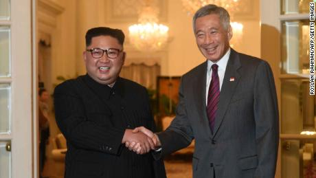 "North Korea's leader Kim Jong Un (L) is welcomed by Singapore's Prime Minister Lee Hsien Loong (R) during his visit to The Istana, the official residence of the prime minister, following Kim's arrival in Singapore on June 10, 2018. - Kim Jong Un and Donald Trump will meet on June 12 for an unprecedented summit in an attempt to address the last festering legacy of the Cold War, with the US president calling it a ""one time shot"" at peace. (Photo by ROSLAN RAHMAN / AFP)        (Photo credit should read ROSLAN RAHMAN/AFP/Getty Images)"
