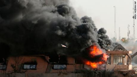 Plumes of smoke rise after a fire broke out at Baghdad's largest storage site for ballot boxes.