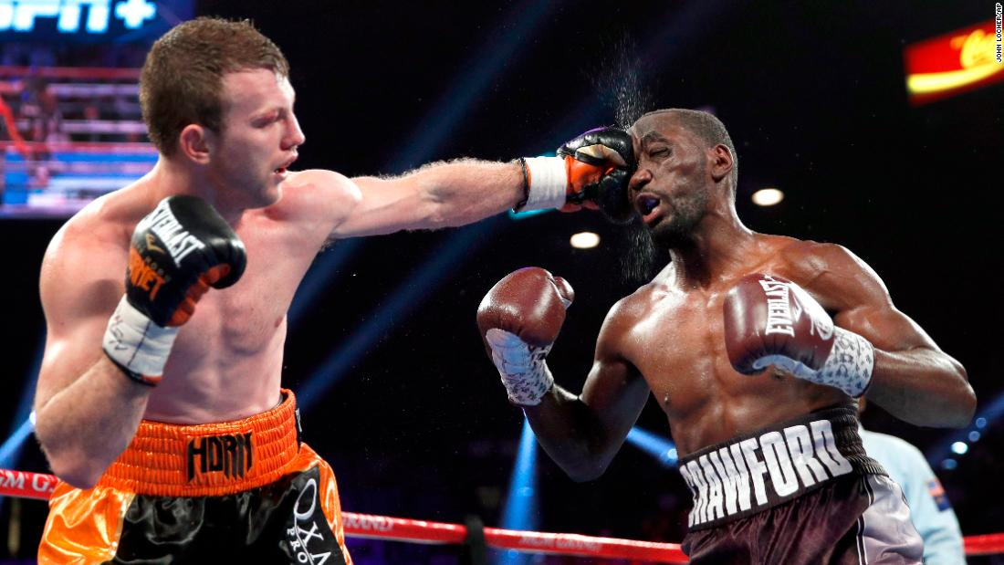Jeff Horn lands a punch on Terence Crawford in a welterweight title boxing match, Saturday, June 9, in Las Vegas.