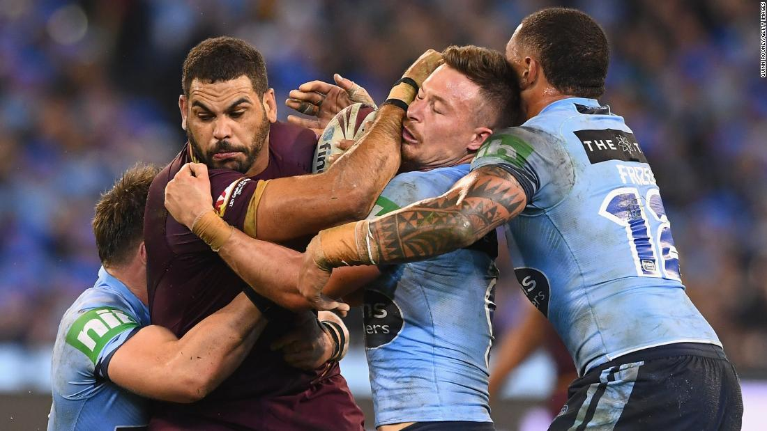 Greg Inglis of the Maroons is tackled during Game 1 of the State Of Origin series between the Queensland Maroons and the New South Wales Blues on Wednesday, June 6, in Melbourne, Australia.