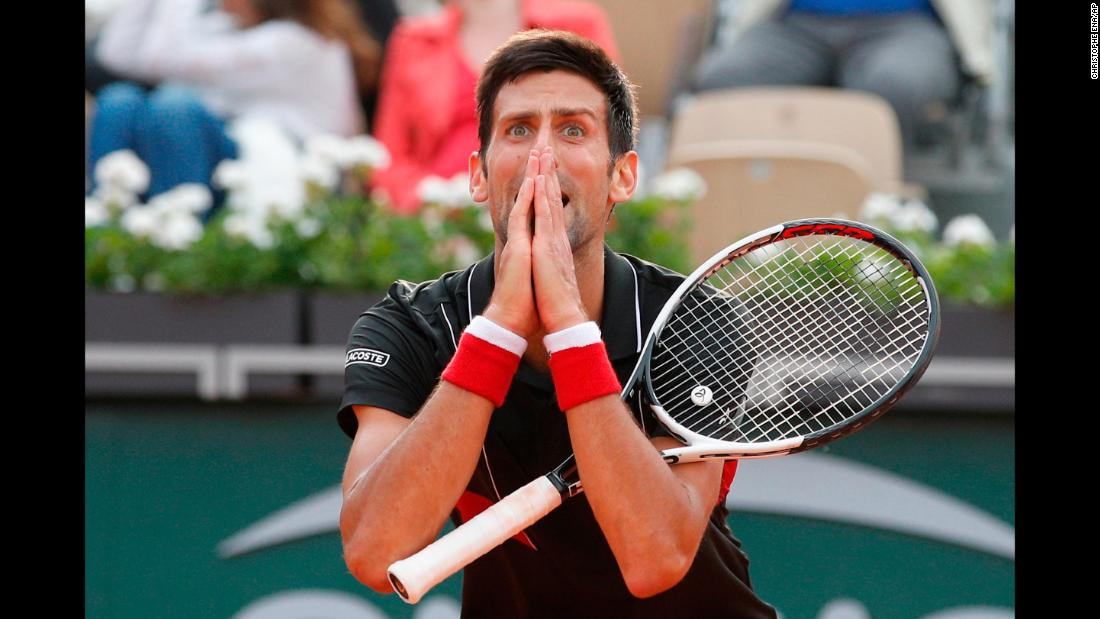 Novak Djokovic reacts after missing a shot against Marco Cecchinato in the tie break of the fourth set of their quarterfinal match at the French Open tennis tournament in Paris, on Tuesday, June 5.