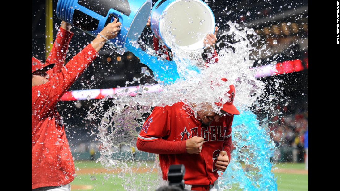 Los Angeles Angels starting pitcher Andrew Heaney is doused with a sports drink following his one hit complete game victory against the Kansas City Royals in Anaheim, California on Tuesday, June 5.