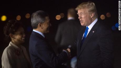 "US President Donald Trump (R) is welcomed by Singapore's Foreign Minister Vivian Balakrishnan (2nd L) upon his arrival at Paya Lebar Air Base in Singapore on June 10, 2018, ahead of a planned meeting with North Korea's leader. - Kim Jong Un and Donald Trump will meet on June 12 for an unprecedented summit in an attempt to address the last festering legacy of the Cold War, with the US president calling it a ""one time shot"" at peace. (Photo by SAUL LOEB / AFP)        (Photo credit should read SAUL LOEB/AFP/Getty Images)"