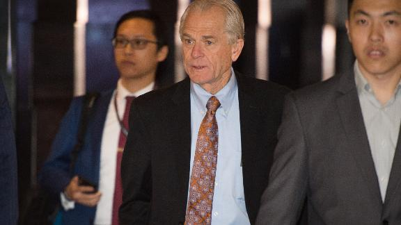White House economic adviser Peter Navarro (C) walks through a hotel lobby as he heads to the Diaoyutai State Guest House to meet Chinese officials for ongoing trade talks in Beijing on May 4, 2018. - Top US and Chinese officials kicked off crucial trade talks on May 3 in Beijing but both sides sought to dampen expectations for a quick resolution to a heated dispute between the world