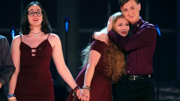 """Students from the Marjory Stoneman Douglas High School drama department react after performing """"Seasons of Love"""" at the 72nd annual Tony Awards at Radio City Music Hall on Sunday, June 10, 2018, in New York. (Photo by Michael Zorn/Invision/AP)"""