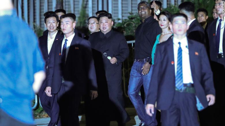 North Korea leader Kim Jong Un, center, is escorted by his security delegation as he visits Marina Bay in Singapore, Monday, June 11, 2018.