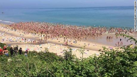 Women gather at Magheramore beach in County Wicklow, Ireland, for the world's largest skinny dip.