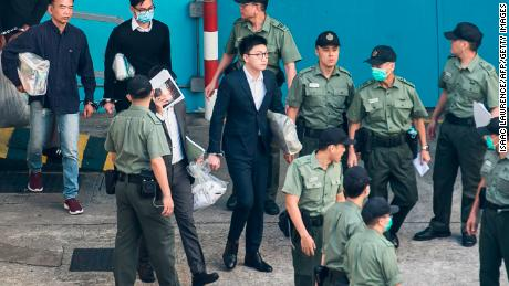 Pro-independence protestor Edward Leung (C) leaves for sentencing on rioting and assaulting a police officer in Hong Kong on June 11.