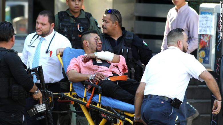 A man wounded during an attack against Secretary of Labour and ex-prosecutor of Jalisco Luis Carlos Najera is assisted in downtown Guadalajara, Jalisco State, Mexico, on May 21, 2018.