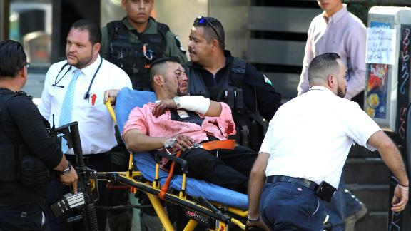 A man wounded during an attack against Secretary of Labour and ex-prosecutor of Jalisco Luis Carlos Najera is assisted in downtown Guadalajara, Jalisco State, Mexico, on May 21, 2018. - Najera was attacked in broad daylight while he was having lunch at a restaurant, officials said. (Photo by ULISES RUIZ / AFP)        (Photo credit should read ULISES RUIZ/AFP/Getty Images)