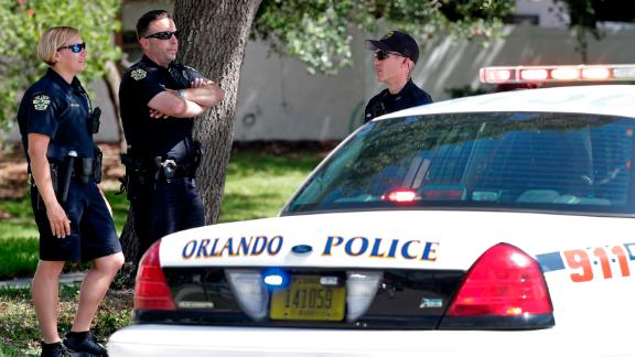 Orlando police block an intersection Monday near an apartment complex where the standoff occurred.