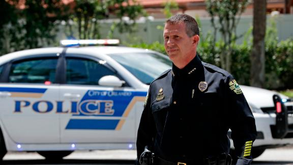 Orlando police Chief John Mina arrives for a news conference during Monday