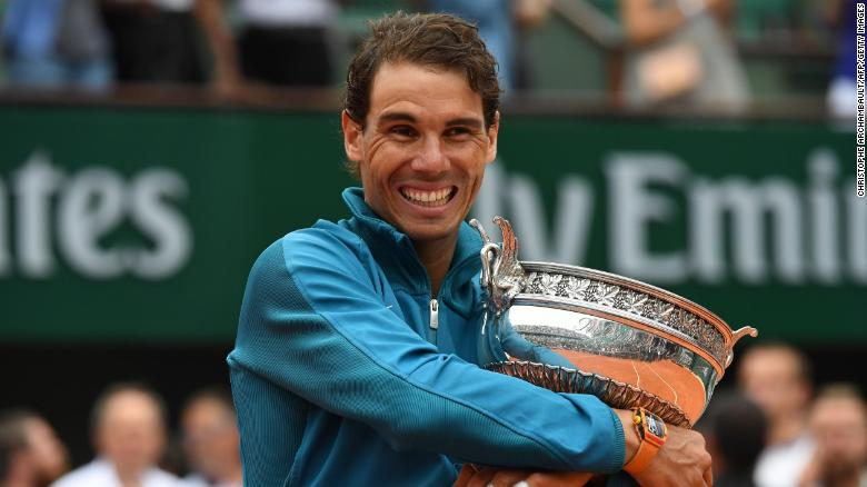 Spain's Rafael Nadal poses with the Mousquetaires Cup (The Musketeers) after his victory in the men's singles final match against Austria's Dominic Thiem, on day fifteen of The Roland Garros 2018 French Open tennis tournament in Paris on June 10, 2018. (Photo by Christophe ARCHAMBAULT / AFP)        (Photo credit should read CHRISTOPHE ARCHAMBAULT/AFP/Getty Images)