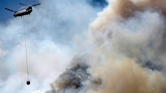 A helicopter works the wildfire on the east side of Hermosa Cliffs near Hermosa, Colorado.