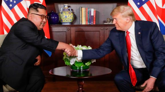 Trump shakes hands with North Korea leader Kim Jong Un during their first meetings at the Capella resort on Sentosa Island Tuesday, June 12, 2018 in Singapore.