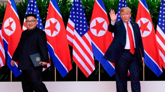 President Donald Turmp waves as North Korea leader Kim Jong Un leaves after their meetings at the Capella resort on Sentosa Island Tuesday, June 12, 2018 in Singapore. (AP Photo/Susan Walsh, Pool)