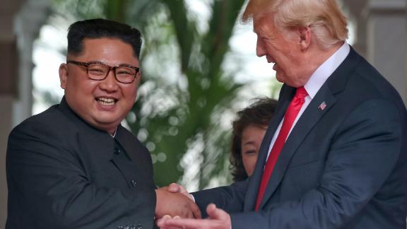 SINGAPORE - JUNE 12: In this handout photo, North Korean leader Kim Jong-un shakes hands with U.S. President Donald Trump during their historic U.S.-DPRK summit at the Capella Hotel on Sentosa island on June 12, 2018 in Singapore. U.S. President Trump and North Korean leader Kim Jong-un held the historic meeting between leaders of both countries on Tuesday morning in Singapore, carrying hopes to end decades of hostility and the threat of North Korea