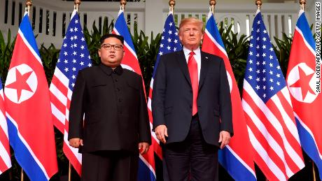 Trump poses with North Korea's leader Kim Jong Un at the start of their historic US-North Korea summit, at the Capella Hotel on Sentosa island in Singapore on June 12, 2018.