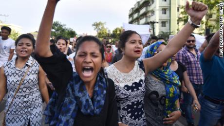 Indian students take part in a protest march demanding action over the killing of two men in the Karbi Anglong district of Assam.
