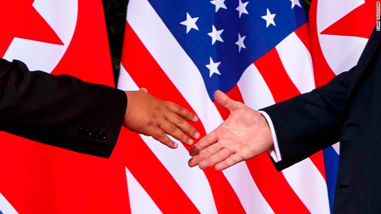 U.S. President Donald Trump, right, reaches to shakes hands with North Korea leader Kim Jong Un at the Capella resort on Sentosa Island Tuesday, June 12, 2018 in Singapore. (AP Photo/Evan Vucci)