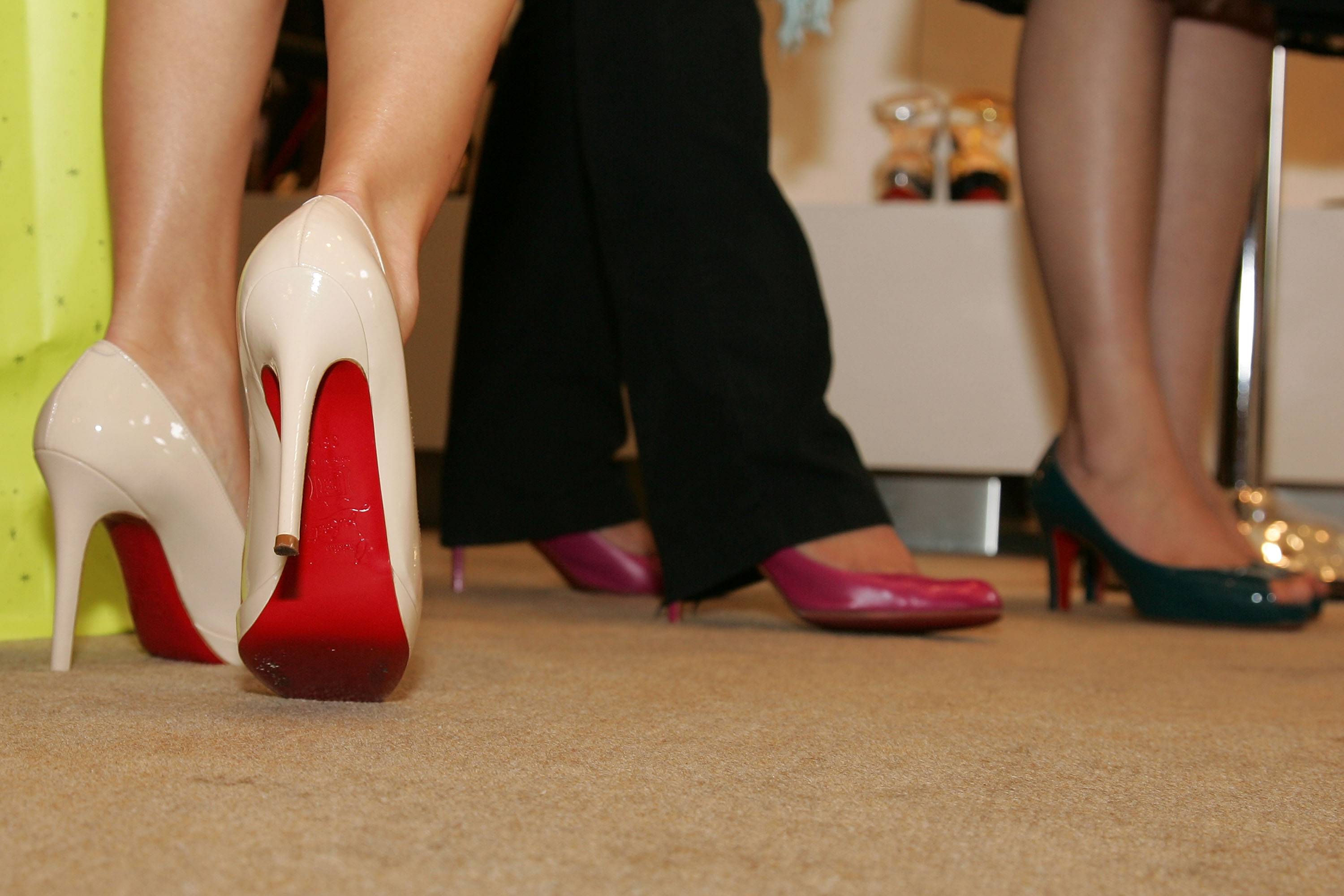 8489a832e03 Louboutin wins fight to trademark red soles