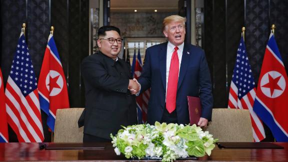 SINGAPORE, SINGAPORE - JUNE 12:  In this handout photograph provided by The Strait Times, North Korean leader Kim Jong-un (L) with U.S. President Donald Trump (R) during their historic U.S.-DPRK summit at the Capella Hotel on Sentosa island on June 12, 2018 in Singapore. U.S. President Trump and North Korean leader Kim Jong-un held the historic meeting between leaders of both countries on Tuesday morning in Singapore, carrying hopes to end decades of hostility and the threat of North Korea