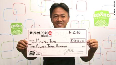 Michael Tran claims his lottery winnings on Tuesday.