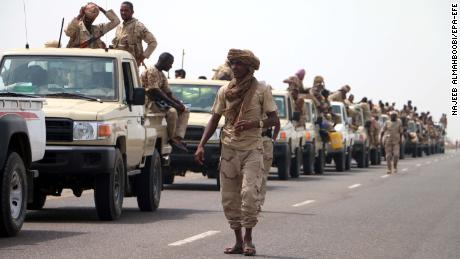 Sudanese forces fighting as part of the Saudi-led coalition in Yemen gather near the outskirts of the western port city of Hodeidah in June.