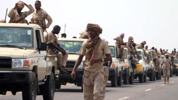 epa06803024 Sudanese forces fighting alongside the Saudi-led coalition in Yemen gather near the outskirts of the western port city of Hodeidah, Yemen, 12 June 2018. According to reports, the Saudi-led military coalition and Yemeni government forces continue to send reinforcements toward the port city of Hodeidah, preparing to launch an assault on the Houthis-controlled main port of Yemen.  EPA-EFE/NAJEEB ALMAHBOOBI