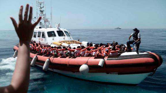 "This undated photo released on Tuesday, June 12, 2018, by French NGO ""SOS Mediterranee"", shows stranded migrants aboard a Italian Coast Guard boat as they are transferred from the SOS Mediterranee"
