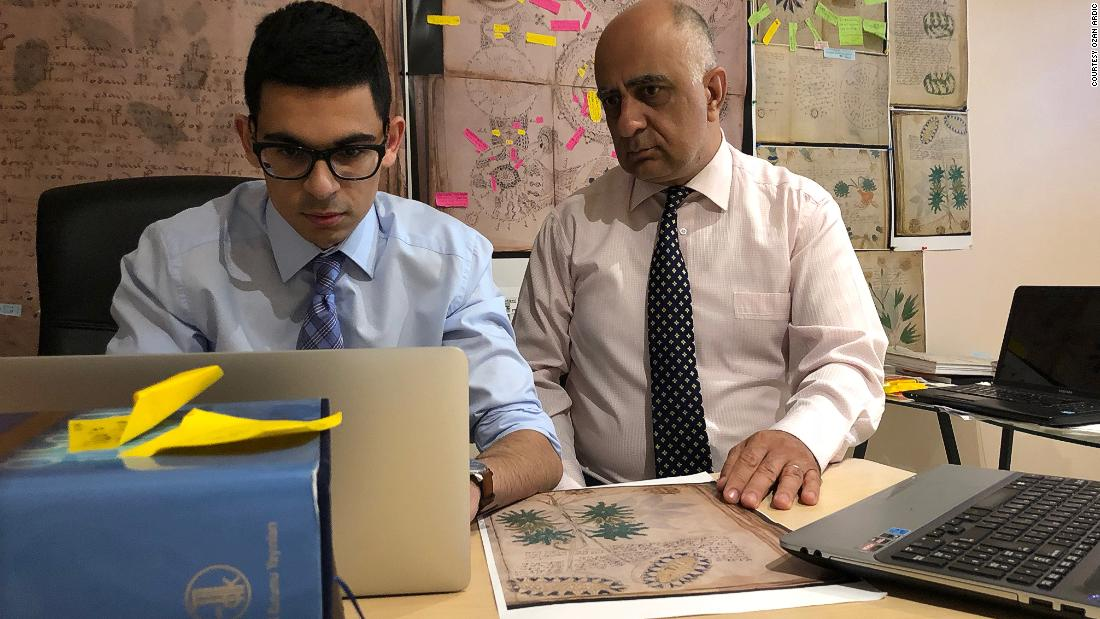 A family in Alberta, Canada, believes the manuscript is written in Old Turkic. Father and son Ahmet (R) and Ozan Ardic have been working on decoding the manuscript for three years. They say they have derived an alphabet of 24 base characters and 64 combined characters from it.