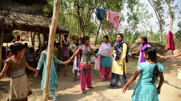 Rajni Devi (center, in light pink) helps coach girls in her small village, in Uttar Pradesh, on how to get an education and achieve dreams beyond marriage.