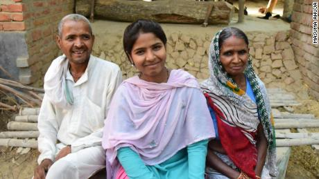 Ranji pictured with her parents in Uttar Pradesh, northern India.