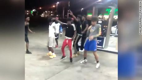 Dancing teens gas station