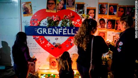 Members of the public hold a vigil near Grenfell Tower in 2018 on the anniversary of the blaze.