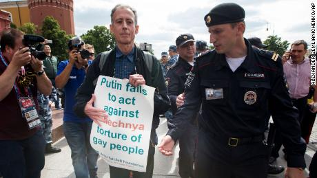 Russian police surround gay rights activist Peter Tatchell, center,  near Red Square in Moscow on Thursday.