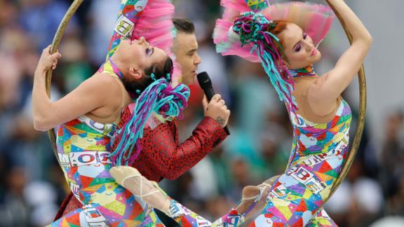 British pop star Robbie Williams headlined the opening ceremony.