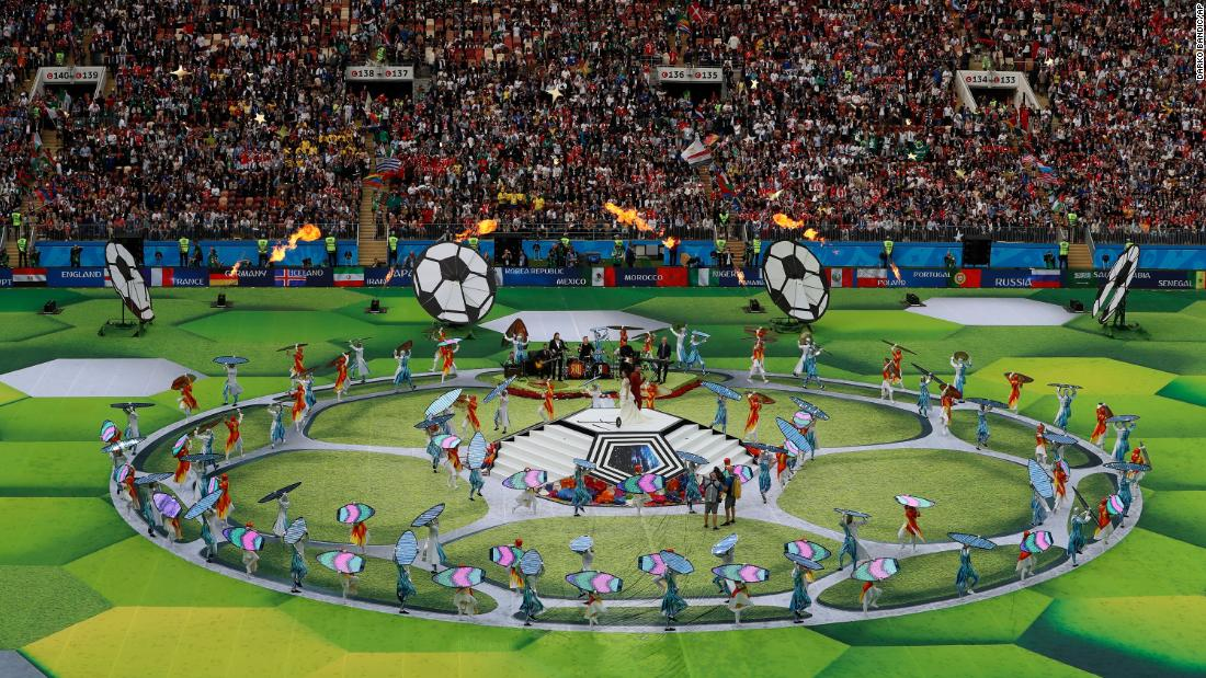 Performers take part in the tournament's opening ceremony.