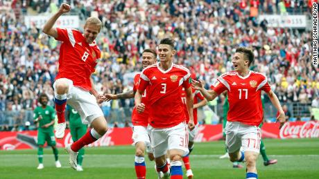 Yuri Gazinsky, left, celebrates with teammates after scoring Russia's opener.