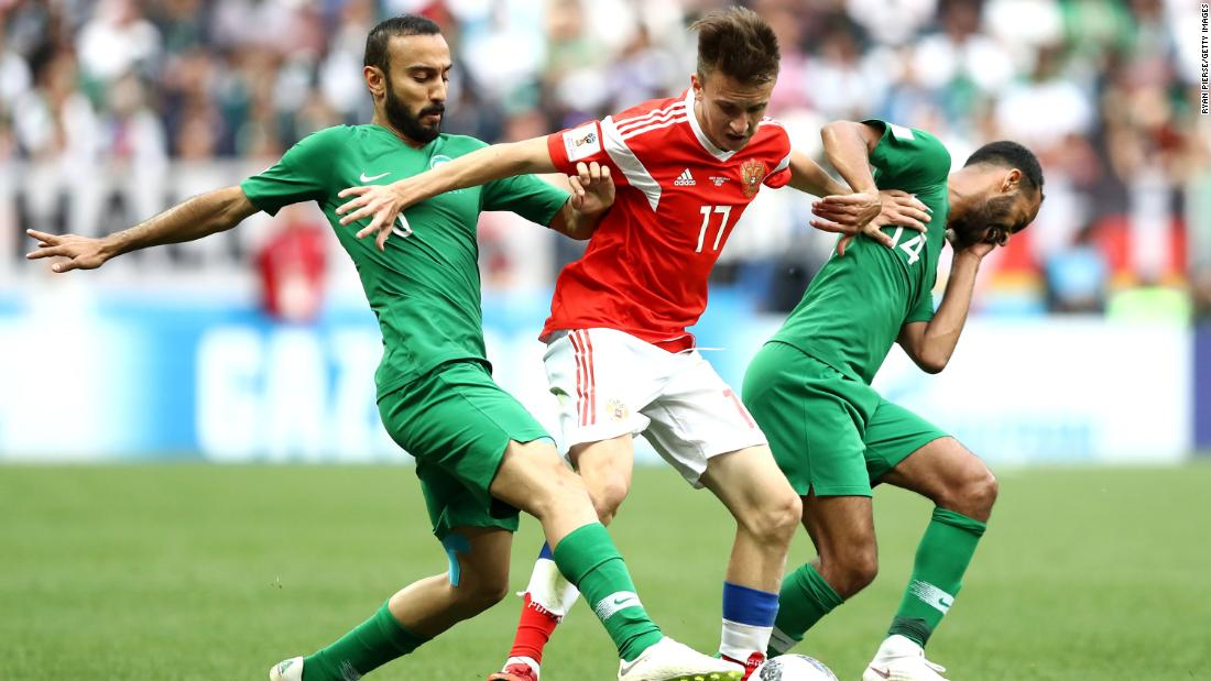 Fedor Smolov fights off two Saudi defenders during the tournament opener, which Russia won 3-0 on June 14. Russia and Saudi Arabia came into the match as the lowest-ranked teams in the tournament.