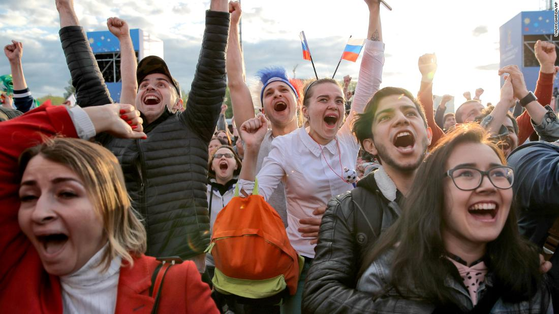 Fans watching from Yekaterinburg, Russia, celebrate Russia's first goal.