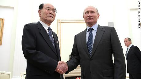 Russian President Vladimir Putin and  senior North Korean official Kim Yong-nam shake hands in Moscow