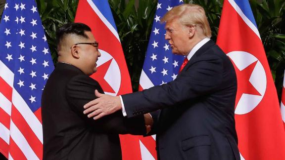 U. S. President Donald Trump shakes hands with North Korea leader Kim Jong Un at the Capella resort on Sentosa Island Tuesday, June 12, 2018 in Singapore. (AP Photo/Evan Vucci)