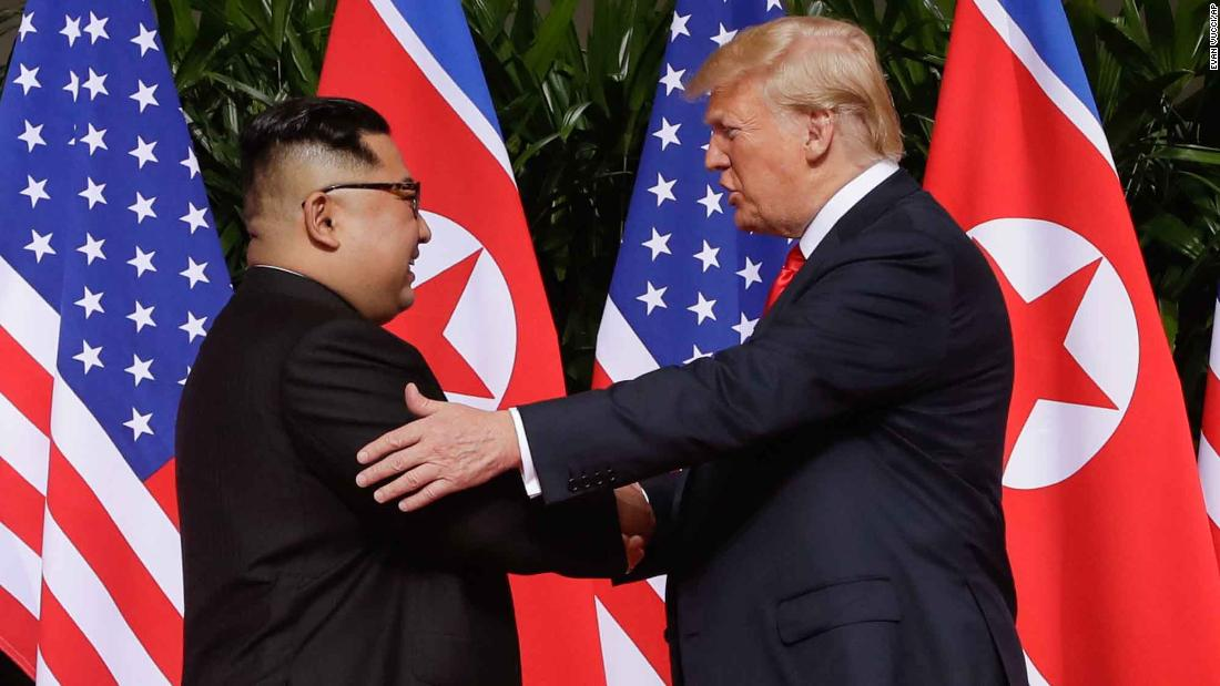 "North Korean leader Kim Jong Un shakes hands with US President Donald Trump at the start of <a href=""https://www.cnn.com/interactive/2018/06/politics/trump-kim-summit-cnnphotos/index.html"" target=""_blank"">their summit in Singapore</a> on Tuesday, June 12. It was the first meeting ever between a sitting US president and a North Korean leader. At the end of the summit, they signed a document in which they agreed ""to work toward complete denuclearization of the Korean Peninsula."" In exchange, Trump agreed to ""provide security guarantees"" to North Korea."