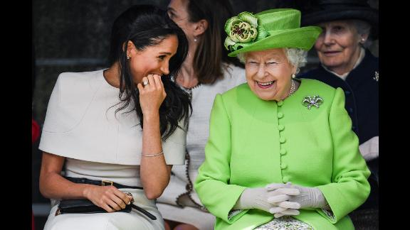 The Queen laughs with Meghan, Duchess of Sussex, during a bridge-opening ceremony in Halton, England, in June 2018. It was Meghan's first royal outing without her husband, Prince Harry, by her side.