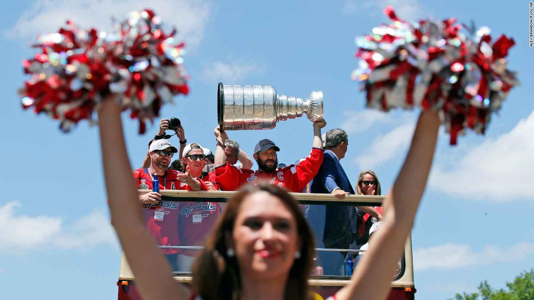 Washington Capitals captain Alex Ovechkin holds up the Stanley Cup during the hockey team's victory parade on Tuesday, June 12. It is the first championship in the franchise's 44-year history.