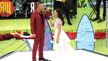 Robbie Williams and Aida Garifullina perform during the opening ceremony.